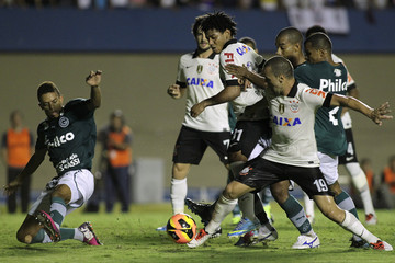 Corinthians' Guilherme fights for the ball with Goias' Matheus during their Brazilian Serie A Championship soccer match at Serra Dourada Stadium in Goiania