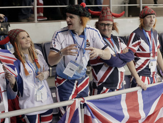 Fans of Britain attend their men's curling semifinal game against Sweden at the 2014 Sochi Winter Olympics