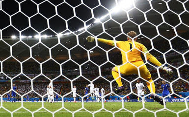 England's Hart is sent the wrong way during a freekick taken by Italy's Pirlo during their 2014 World Cup Group D soccer match at the Amazonia arena in Manaus