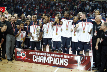 Head coach Krzyzewski of U.S. joins his players as they celebrate with the trophy after defeating Turkey in the FIBA Basketball World Championship final game in Istanbul