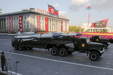 Missiles are taken on trucks past a stand with North Korean leader Kim Jong Un during the parade celebrating the 70th anniversary of the founding of the ruling Workers' Party of Korea, in Pyongyang