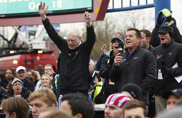 Berkshire Hathaway chairman Buffett gestures at a 5km race sponsored by Brooks Sports Inc. in Omaha