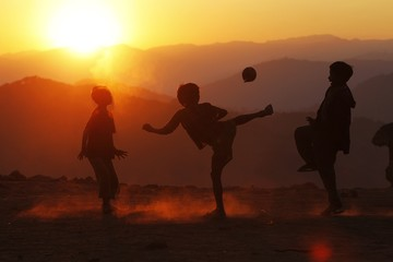 Boys play with a ball in Yansi village, Donhe township in the Naga Self-Administered Zone