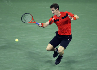 Andy Murray of Britain chases down a forehand to Michael Llodra of France at the U.S. Open tennis championships in New York