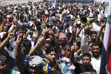 Sunni Muslims chant during an anti-government demonstration in Falluja