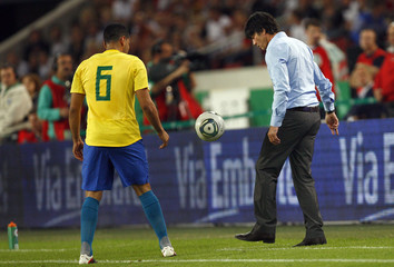 Germany's coach Loew reacts during their friendly soccer match against Brazil in Stuttgart