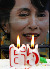 A birthday candle lit in front of an image of democracy leader Aung San Suu Kyi during a protest outside Myanmar's embassy in Manila