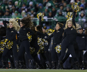 Hamilton Tiger-Cats cheerleaders perform during a timeout in the second half of the CFL's 101st Grey Cup championship football game in Regina