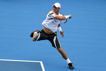 Australia's Hewitt jumps as he hits a shot during his finals match against Argentina's Del Potro at the Kooyong Classic tennis tournament in Melbourne