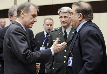 Poland's Defence Minister Klich talks with Afghanistan's Defence Minister Wardak during a NATO-Afghanistan defence ministers meeting in Brussels