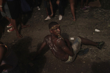 A worshipper pauses from crawling on the ground during the annual celebratory pilgrimage in Portobelo