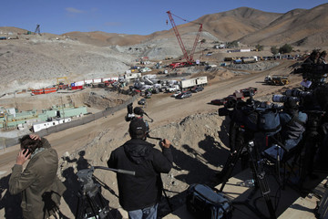 Journalists, photographers and cameramen cover the operation to rescue the trapped miners at the San Jose mine in Copiapo