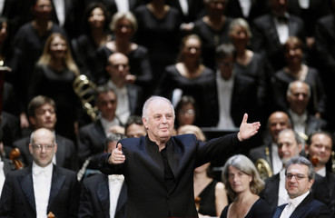 Barenboim, musical director of Milan's La Scala opera house, gestures to the audience during a performance at the Bolshoi Theatre in Moscow