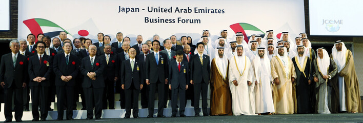 Japanese Prime Minister Shinzo Abe and the UAE Energy Minister Suhail Al Mazroui pose with other delegates from the two countries during the opening of Japanese and UAE Business forum in Abu Dhabi