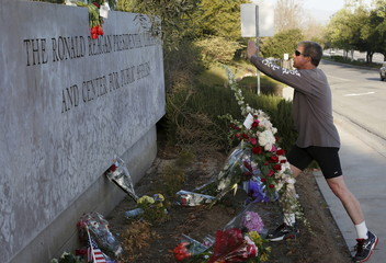 Kalish takes a picture of flowers placed on sign at The Ronald Reagan Presidential Library in honor of former First Lady Nancy Reagan, who died at the age of 94, in Simi Valley, California