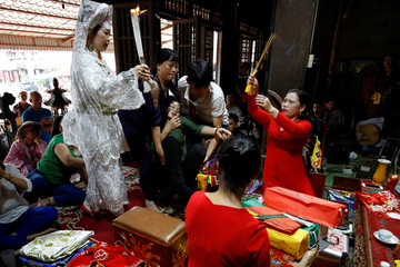 The Wider Image: Vietnam's spirit mediums revive once forbidden ritual