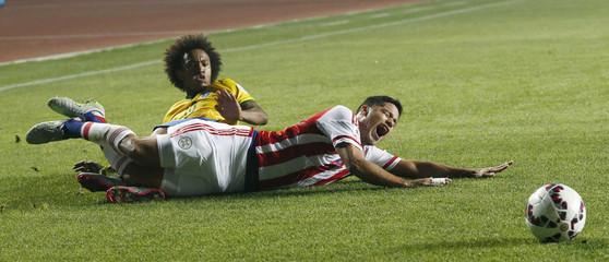 Paraguay's Valdez is tackled by Brazil's Willian during their Copa America 2015 quarter-finals soccer match at Estadio Municipal Alcaldesa Ester Roa Rebolledo in Concepcion