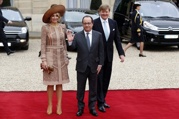 French President Francois Hollande, King Willem Alexander and Queen Maxima of the Netherlands leave after a meeting at the Elysee Palace in Paris