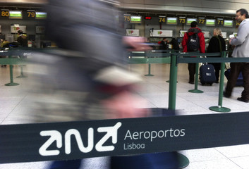 Passangers arrive at the check-in counters at Lisbon's airport