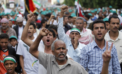 Protesters shout slogans during a demonstration to demand that Yemen's former President Ali Abdullah Saleh to be put on trial in Sanaa