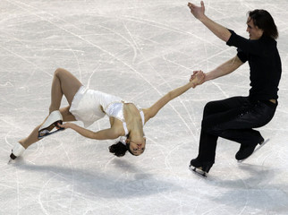 Canac and Coia of France perform during the pairs short program at the European Figure Skating Championships in Tallinn