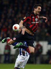 Porto's Fernando challenges Eintracht Frankfurt's Joselu during their Europa League soccer match in Frankfurt