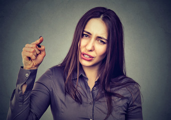 angry woman pointing her finger accusing someone