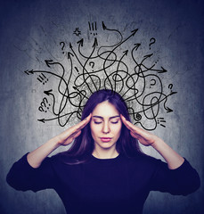 Stressed woman has too many thoughts