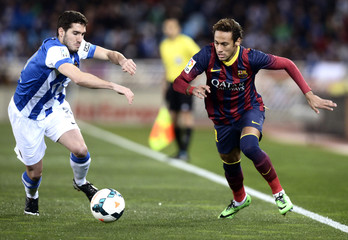 Barcelona's Neymar fights for the ball with Real Sociedad's Zaldua during their Spanish first division soccer match at Anoeta stadium in San Sebastian