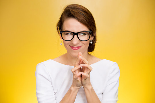 crazy looking sly woman in black glasses