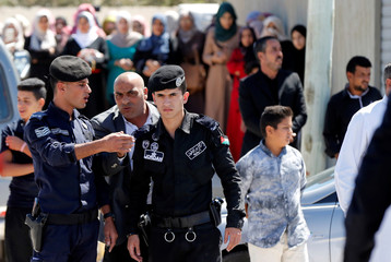 Jordanian police stand guard as relatives of Saed Amro, the Jordanian who was shot dead by Israeli police at the Damascus gate in Jerusalem's old city on September 16, attend his funeral in the town of Mugheir