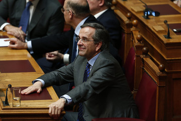 Greece's Prime Minister Samaras smiles during the second of three rounds of a presidential vote at the Greek parliament in Athens