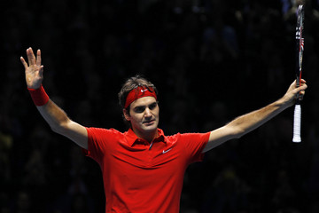 Switzerland's Federer reacts after winning his single match against Sweden's Soderling at the ATP World Tour Finals in London