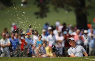 Rory McIlroy of the Northern Ireland hits from a sand trap on the seventh hole during second round play in the 2013 Masters golf tournament in Augusta