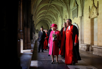 Britain's Queen Elizabeth II  walks through cloisters of Westminster Abbey during visit to Westminster Abbey and Westminster School in London
