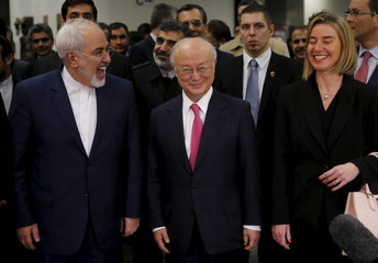Iranian FM Zarif, IAEA Director General Amano and the High Representative of the European Union for Foreign Affairs and Security Policy Mogherini arrive at the United Nations building in Vienna