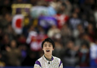 Yuzuru Hanyu of Japan reacts after performing the men's singles free skating program at the ISU Grand Prix of Figure Skating in Nagano, Japan