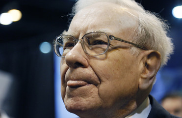 Berkshire Hathaway CEO Buffett reacts to a reporter's question during a trade show at the company's annual meeting in Omaha