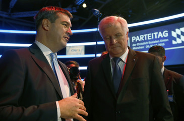Bavarian Prime Minister and head of CSU Seehofer listens to Bavarian Finance Minister Soeder during CSU party congress in Munich
