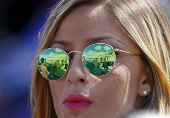 A woman attends Pope Francis' Sunday Angelus prayer in Saint Peter's Square at the Vatican