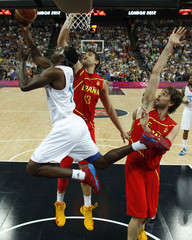 France's Pietrus goes in for a lay-up past Spain's Gasol brothers during their men's quarterfinal basketball match at the North Greenwich Arena in London during the London 2012 Olympic Games