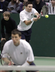 Britain's Fleming returns the ball during their Davis Cup match with Lithuania's Sakinis and Grigelis in Vilnius
