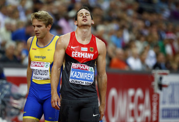 Kazmirek of Germany and Rosenquist of Sweden react after competing in the men's 400 metres decathlon heats during the European Athletics Championships at the Letzigrund Stadium in Zurich