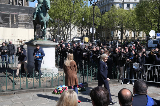 France's far right National Front political party leader Marine Le Pen leaves after laying flowers at the bottom of the statue of Jeanne d'Arc (Joan of Arc) as part of the National Front's annual May Day ceremonies in Paris