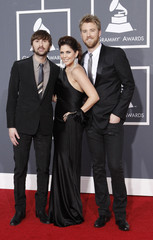 Members of Lady Antebellum arrive on the red carpet at the annual Grammy Awards in Los Angeles