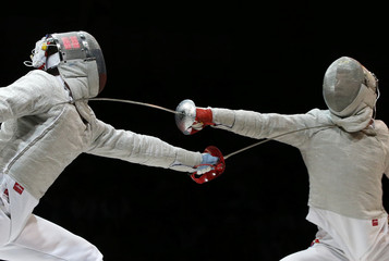 Gu of South Korea competes against Yakimenko of Russia during their men's sabre semi-final at the World Fencing Championships in Kazan