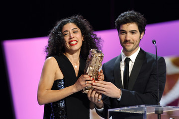 """Actress Naidra Ayadi reacts as she receives the Best Female Newcomer Award for her role in the film """"Polisse"""" during the 37th Cesar Awards ceremony in Paris"""