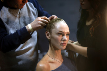 Models are prepped backstage before the Jason Wu Fall/Winter 2012 collection presentation during New York Fashion Week