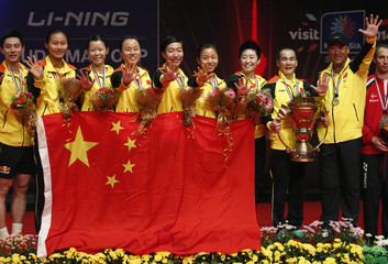 China's badminton team head coach Li holds the trophy after winning against South Korea during the Sudirman Cup World Team Badminton Championships in Kuala Lumpur