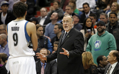 Minnesota Timberwolves head coach Rick Adelman smiles at Timberwolves guard Ricky Rubio in win against Detroit